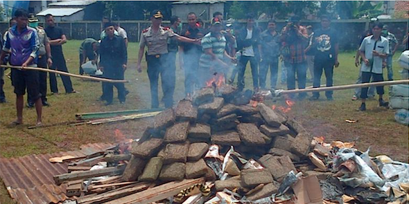 That time the Indonesian cops got a whole village high burning three tons of dope. image via Rappler